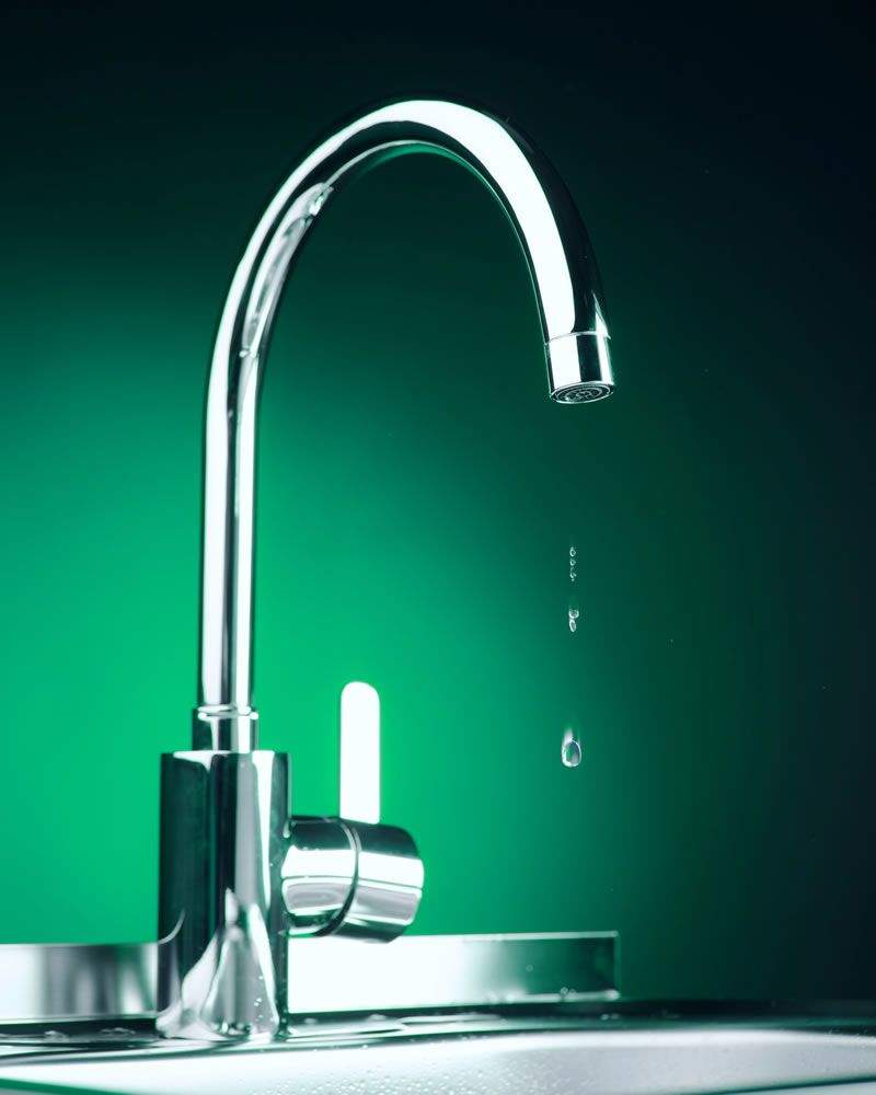 Chrome plated monobloc mixer kitchen tap that is dripping