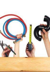 Plumbing tools and equipment used by plumbers including wrench hoses stopcock measuring tape and trap