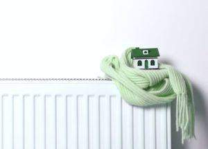 Central heating radiator with a scarf and house